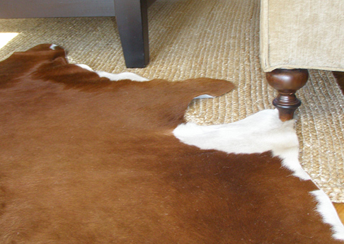 Cowhide Rug over a Jute